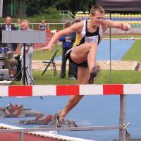 man jumping hurdle