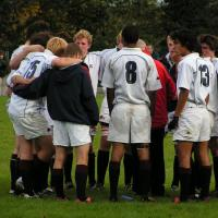 sports team in a huddle