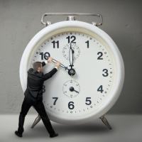 man stopping clock hand