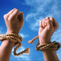 Hands breaking free of restraints
