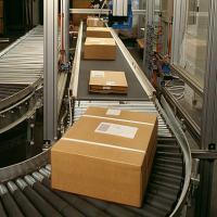 Conveyor belt delivering boxes