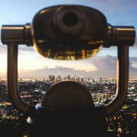 Binoculars over cityscape