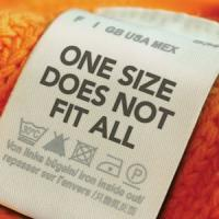 "Shirt tag saying ""One size does not fit all"""