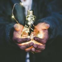 Man holding a light bulb