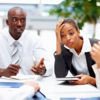 A businesswoman dealing with a difficult man
