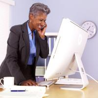Woman standing up from desk