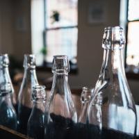 Row of bottles lined up, photo by Andrew Seaman