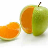 Apple cut open to reveal an orange inside