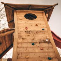 Climbing tower on a playground, photo by Basil Lade