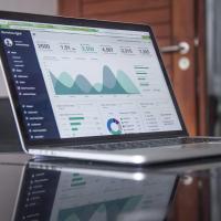 Computer dashboard showing metrics, photo by Carlos Muza