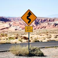 Sign indicating twisting roads ahead