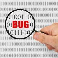 """A magnifying glass showing the word """"bug"""" among code"""