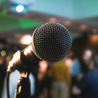 Microphone on stage at a software conference