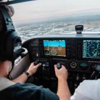 A cockpit's dashboards as a pilot flies a plane, photo by Kristopher Allison