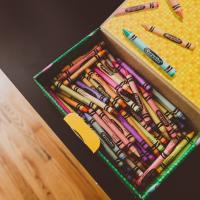 A box of crayons, photo by Leisy Vidal
