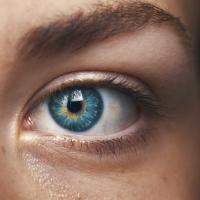 Close-up photo of someone's blue eye, by Amanda Dalbjörn