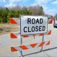 "Roadblock sign reading ""Road closed"""