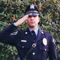 Police officer in uniform saluting