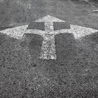 Asphalt with painted arrows pointing in three directions