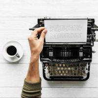 Person typing at a typewriter