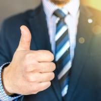 Tester in a business suit giving a thumbs-up