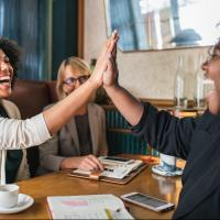 Two software teammates slapping high five