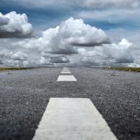 Road leading toward clouds