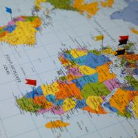 Flags stuck in countries on a map