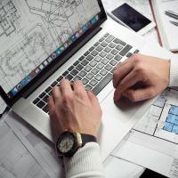 Architect designing plans on a laptop