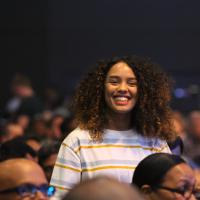 Smiling woman attending a software conference