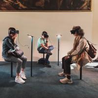 People wearing virtual reality headgear