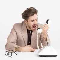 Client yelling into a phone