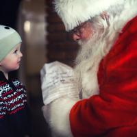 Santa Claus talking to a child