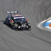Racecar navigating around a turn