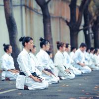People practicing in a dojo