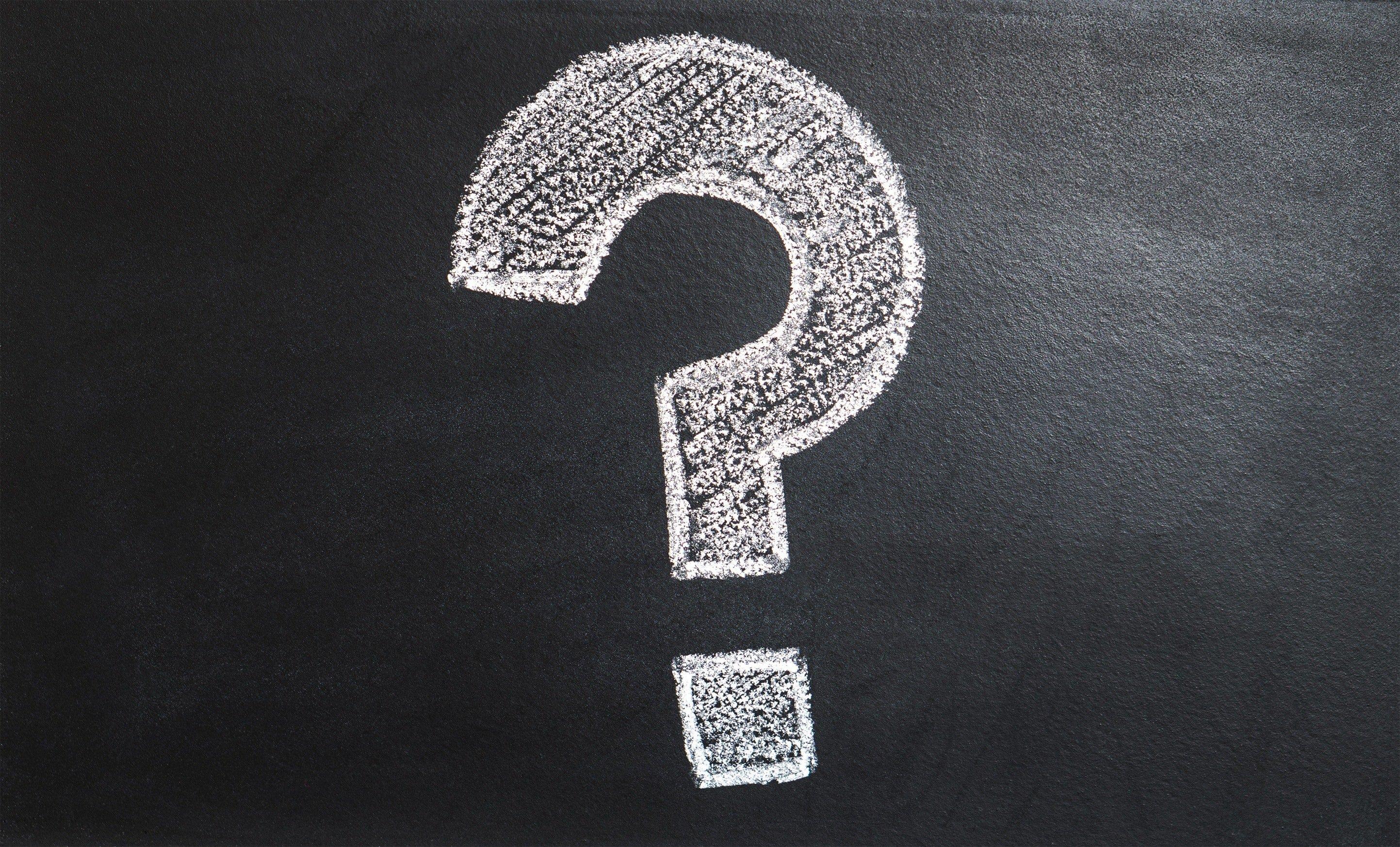 Question mark drawn on a chalkboard