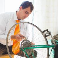 Scrum team member fixing a bicycle
