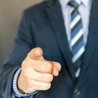 Man in a suit pointing his finger