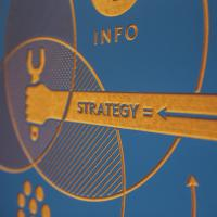 """Sign with an arrow pointing toward the word """"Strategy"""""""
