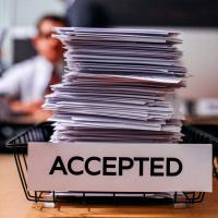 Pile of documents in an inbox