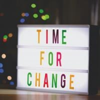 "Light-up sign reading ""Time for change"""