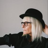 Stylish older woman with gray hair wearing a fedora