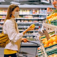 Woman wearing a mask going grocery shopping