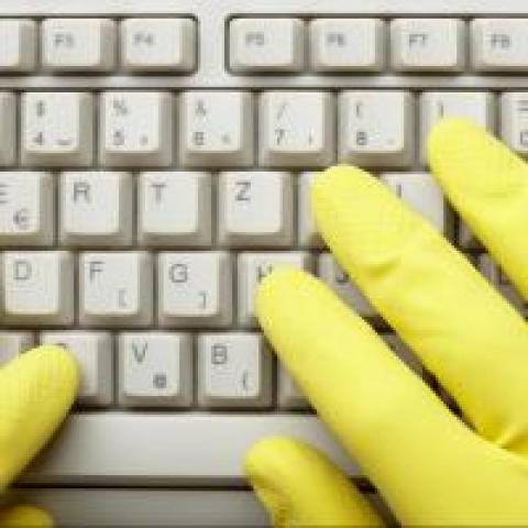 gloved hands on keyboard