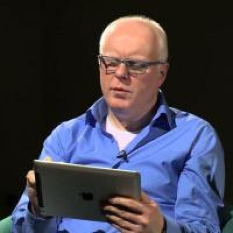 man reading on ipad
