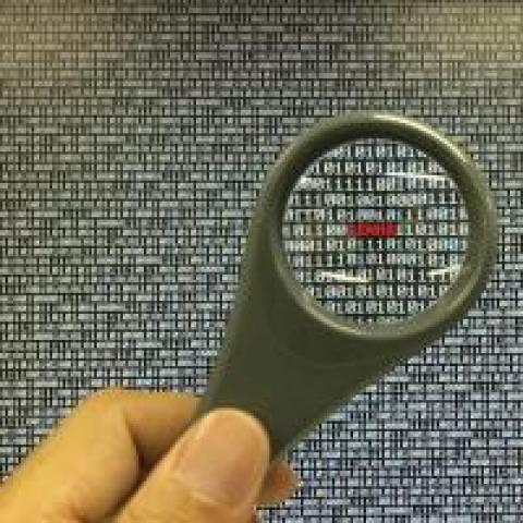 magnifying glass looking at code