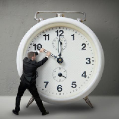 man stopping clock hand