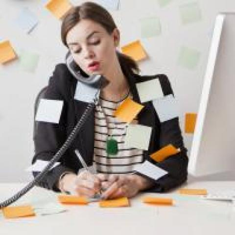 Woman covered in sticky notes