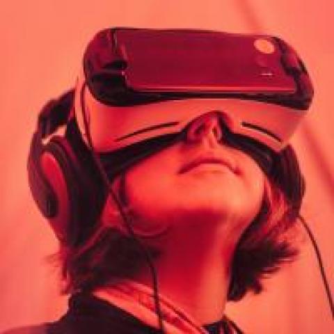Person wearing VR headset, photo by Samuel Zeller