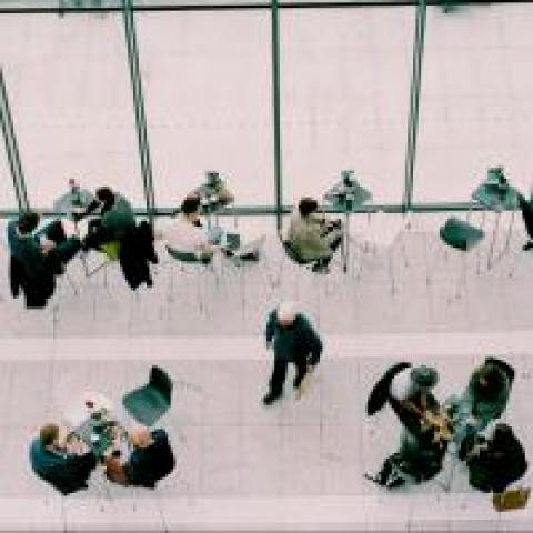Groups of people networking at a conference